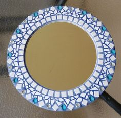 One of my first projects. A mosaic mirror.