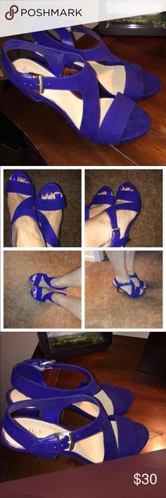 """Royal Blue Size 8 worn  once for a wedding Royal Blue Size 8 worn for a wedding  Your perfect simple sandal is here! The Petra sandal from Kelly & Katie is a platform high heel that you can pair with anything from denim to dresses. Faux suede upper with shimmer finish Ankle strap with adjustable buckle Asymmetrical strap style 4"""" covered heel Synthetic sole Imported Kelly & Katie Shoes Sandals"""