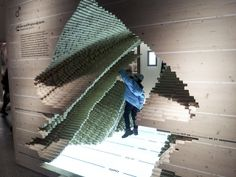 """Data sculpture at Berlin's Museum für Naturkunde showing a sliced 3D view of the """"population pyramid"""" graph for the German population 1900-2..."""