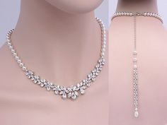 Elegant and sophisticated!  The beautiful Lily jewelry set is one of our most popular designs. Glamorous statement necklace which features Swarovski pearls and brilliance cubic zirconia in round, navette, and teardrop crystals that sparkle radiantly. This gorgeous jewelry set is the perfect finishing touch for your special day. NECKLACE: *Necklace measures: 16 long with 2 extension chain if ordered without backdrop. *Length of backdrop: 7 long, custom length available upon request…