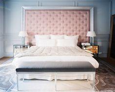 Love this bedroom! Light pink tufted headboard, mirrored nightstands.