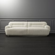 Shop Logan Grey Boucle Sofa. Round in all the right places, textured sofa draws inspiration from postmodern Italian architecture. Leonard Pfeifer's design sits low and deep, upholstered in a lush looped fabric that feels like a true boucle (but costs a lot less).