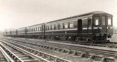 A view across the line towards a six-car train of Metropolitan Railway 1905 electric stock.