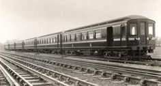 A view across the line towards a six-car train of Metropolitan Railway 1905 electric stock.