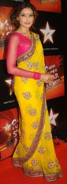 A dazzling bright yellow Sabyasachi sari with fuchsia chiffon long-sleeved blouse.