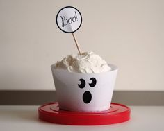 "Very basic, but cute: ghost cupcake wrapper (printed onto plain white paper, then cut out) + ""Boo!"" topper."