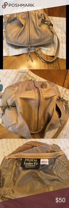 Victoria Leather Company Slouch Bag This bag is luxurious to the touch with a nice sized compartment.  There are two slide pockets on each side.  Tan lining goes to the zippers length and the slide pockets.  Turned bag inside out to give an idea.  This is a vintage bag so there is wear on brass hardware. Two large side pockets on outside, one zippered and one slide.  One large pocket in front.  Overall bag is in great condition just needs cleaning.  One small spot on lower back of purse was…