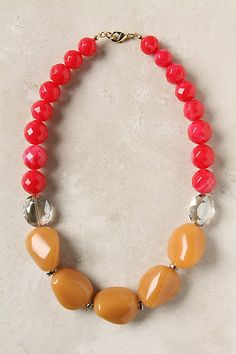 anthropologie $42 but so easy to make yourself. Faceted red and clear beads with brown stones