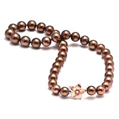 """Chocolate Tahitian Pearl Strand:: A strand of graduated round """"Chocolate"""" Tahitian Pearls, 10-13mm and bronze in color, fully knotted, with a 14K two-tone rose & white-gold Plumeria clasp set with one faceted round Diamond totaling 0.05 carats, total weight, 17.5"""" in length."""
