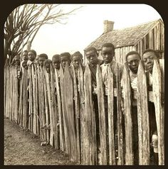 SLAVES, EX-SLAVES, and CHILDREN OF SLAVES IN THE AMERICAN SOUTH, 1860 -1900 (21)...........Free at last, behind a fence