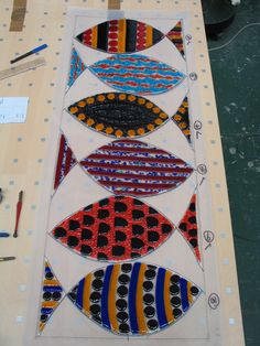 All the fused fish laid out on the pattern to check it all fits before leading it all together.