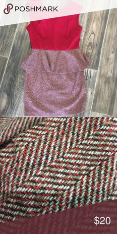Crimson red peplum dress. Wool texture bottom Red top and wool peplum bottom with woven print. Colors in wool are cream,tan, red, and black. Esley Dresses Midi