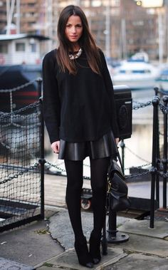 street style sexy oversized sweater and black leather skort combnation