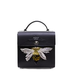 Black vegetable tanned leather backpack with handcrafted 3D bee embroidery from the Yunnan and Dali region. Available on DreamsCode.co.uk