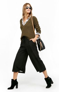 Photos via: Daily Look Loving this layered culottes look for the office! The bucket bag and mix of stripes with plaid add to it's cool feel. Just switch to pumps and this has after-work drinks written