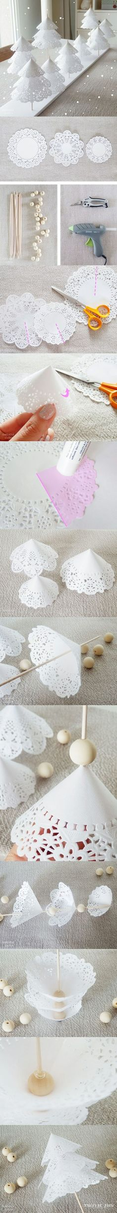 I would use bits of white styrofoam peanuts between doilies....cheaper and would not show!