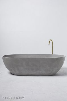 With it's streamlined edges and curved sides, the Valencia Bath is the perfect luxury for two. Concrete Bathtub, Concrete Basin, Valencia, Zen Garden Design, Australia House, Ghost House, Big Bathrooms, Wooden Bathroom, Laundry Room Design