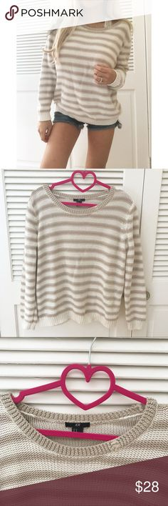"""H&M Slouchy Sparkly Striped Knit This Knit was gently worn and in great condition! Features a Slouchy style knit top. Beige/muave striped pattern. If you look closely there are gold sparkles. Minor flaw on neckline- loose threads. It can looks like l the """"Distressed"""" style. Not a thin top at all. 24"""" Shoulder to hem. Offers welcome!! H&M Tops"""
