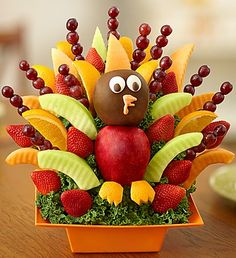 """This Thanksgiving, finish the feast with a fun & festive treat. Our unique fruit creation is designed to look just like a plump, juicy turkey. Complete with two crisp apples for the """"head"""" and """"body"""" and an assortment of juicy melon, strawberries, oranges and grapes for """"feathers,"""" this delicious dessert is guaranteed to get gobbled up!"""