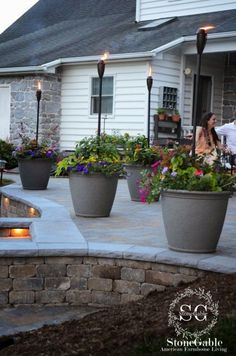 pots and torches Add lanterns, torches and solar lights to your outdoor space. What a wonderful way to add mood lighting! They can be moved around unlike wired lighting. I use battery operated candles on timers to get the most glow from my lanterns! These torches from Tiki Brand have a solar light that lights up from dusk to dawn!