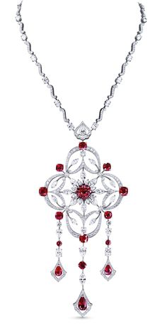 Mixed cut ruby and diamond necklace by Asprey. Details:  9 cushion cut rubies (tot 14.23) set in the pendant Pear, marquise, brilliant and oval cut diamonds (tot 31.02)