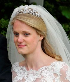 A second photo of Emily Fellowes, wearing a diamond floral tiara. No idea whether the tiara is from the bride or groom's family, but her mother, the late Princess Diana's sister, did wear the Spencer tiara to her own wedding.
