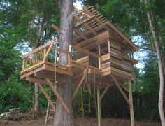 This fabulous treehouse looks like an architectural model to me, with thoughtful overhangs to mitigate direct sunlight and an assemblage of reclaimed wood. It also looks like a lot of fun with its ropes and ladders, which is the point after all.