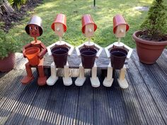 Garden ornament two on a solar bench – Artofit Outdoor Crafts, Outdoor Projects, Wood Projects, Clay Pot Crafts, Crafts To Make, Wooden Garden Ornaments, Wood Log Crafts, Flower Pot People, Landscape Timbers