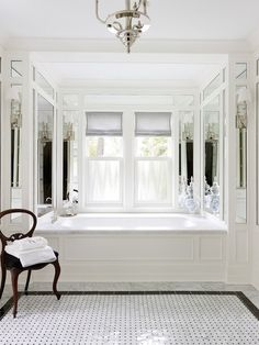Labelled tub, knock out small window, replace it with bigger ones, mirrors on walls, white walls, carerra marble