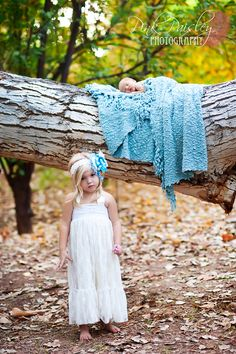 Love using a blanket and nature.  Simple dress for big sis with coordinating hair piece.