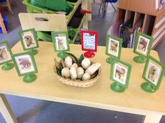 Reception : UW/LIT Dinosaurs are hidden in play dough eggs. Children discover what's in the egg. Place dinosaur next to corresponding dinosaur picture name card.