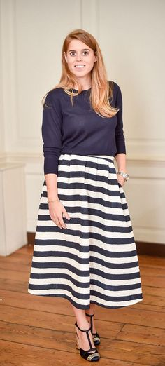 Princess Beatrice looked elegant in a navy and white midi skirt, which she teamed with a matching fine knit jumper. She completed the look with a pair of statement t-bar shoes with mottled gold heels.