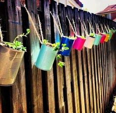 tin hanging herb garden--would definitely keep the rabbits away! only a picture, no link tin hanging herb garden--would definitely keep the rabbits away! only a picture, no link Cute Garden Ideas, Fence Ideas, Garden Ideas Near Fence, Colourful Garden Ideas, Jardin Decor, Hanging Herbs, Hanging Plants On Fence, Hanging Planters Outdoor, Outdoor Plants