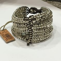 Uno de 50 bracelet Woman leather bracelet with several rows of rings and square beads in silver-plated metal alloy. 100% authentic, comes in cloth uno de 50 bag. Jewelry Bracelets
