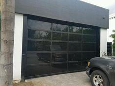 Contemporary Black Aluminum & Black Laminate (Privacy) Glass Garage Door