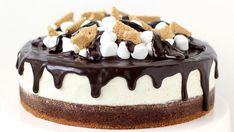 Layers of decadent chocolate brownie, marshmallow cheesecake fluff, and chocolate ganache are topped with marshmallows and graham crackers.