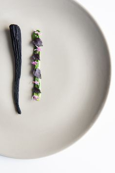 This beautifully minimalist amuse bouche recipe from Heinrich Schneider sees purple carrots served alongside a silky herb emulsion and vibrant herb jelly strips. The carrots are cooked sous vide before dehydrating to achieve an intense, concentrated flavour.