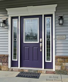 Need to refinish front doors, keep this same color they are now, maybe go brighter? Change framing trim to Swiss Coffee to match other house trim. Purple is the new red! Shades of purple are increasing in popularity as a bold entry door color. Purple Front Doors, Purple Door, Painted Front Doors, Front Door Colors, Colored Front Doors, Exterior Gris, Exterior Door Colors, Exterior Paint, Exterior Design