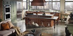Brown cabinetry with a unique table surrounding the kitchen island. It's classic, yet modern.