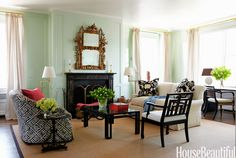 """For the living room of a traditional New York apartment, designer Todd Klein chose a light, cool green. """"If you think of a house as having seasons, the living room is spring,"""" Klein says."""