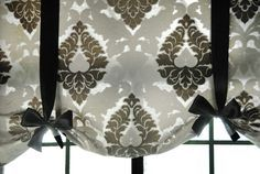 Front entry: make a short ribboned valance to cover front door roman shade. Need black ribbons, curtain bar, fabric