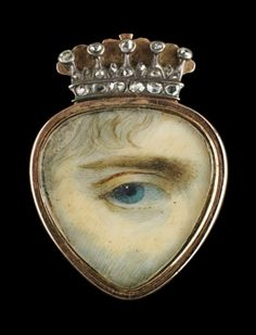Gold ring with heart-shaped miniature surmounted by gold-and-diamond crown; blue right eye. Red silk ribbon under glass on reverse.