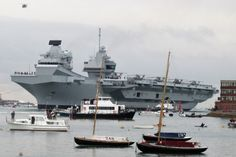 HMS Queen Elizabeth is being formally commissioned on Thursday. Hms Prince Of Wales, Hms Ark Royal, Hms Queen Elizabeth, Navy Carriers, Hampshire Uk, Capital Ship, Local Attractions, Diesel Locomotive, Navy Ships
