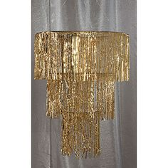 The Gold Three Tier Chandelier features thousands of intricately detailed metallic mylar strands. Each of the gold tier chandeliers hangs 3 feet and is 32 inches in diameter.