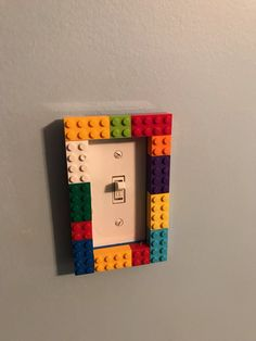 Lego Bedroom This is a great light switch, with 2 layers so kids can switch the positions of the LEGO. is the perfect Lego room storage idea for keeping your boys Lego room tidy and organized. Lego Boys Rooms, Boys Lego Bedroom, Lego Bedroom Decor, Lego Room, Boy Room, Boy Bedrooms, Playroom, Minecraft Bedroom, Deco Lego