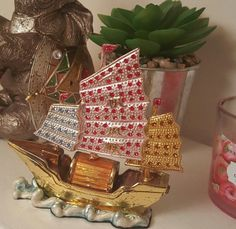 Check out this item in my Etsy shop https://www.etsy.com/listing/475475925/vintage-rhinestone-viking-sail-boat