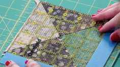 Center point on ruler aligned with center point on quilt block