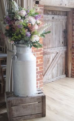 Milk churn of pale pink peony, vuvuzela roses, peach lisianthus, cream spring… Church Wedding Flowers, Lilac Wedding Flowers, Green Wedding, Bouquet Champetre, Hydrangea Bouquet, Country Barn Weddings, Table Flowers, Milk Cans, Wedding Decorations