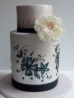 Black and white double barrel cake with peony and brush embroidery