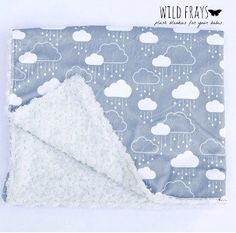 "1 large ""rain clouds white and gray"" baby blanket {size 31""x39""} with an ivory rosette backing"